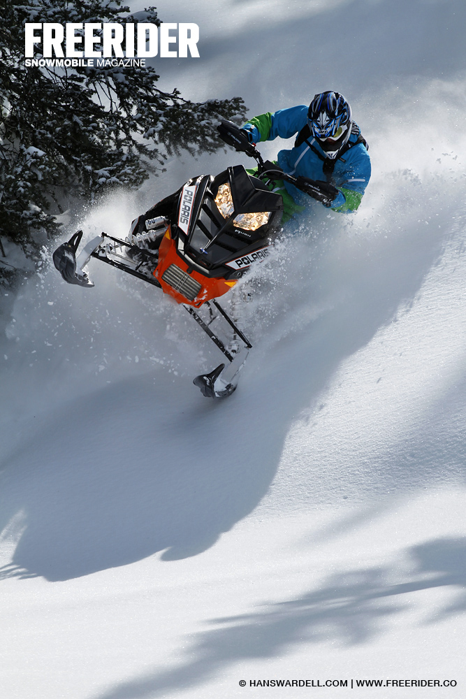 Jerry-Fredriksson-sledding-powder-with-a-Polaris-in-the-mountains-of-Montana-USA-Shot-by-Hans-Ward-wallpaper-wp4408740