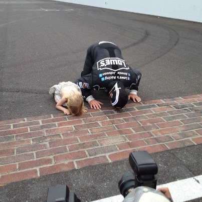 Jimmie-and-daughter-kissing-the-bricks-after-his-win-on-wallpaper-wp3007518