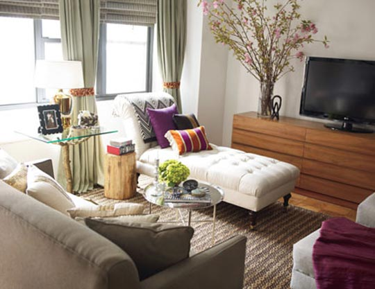 Living-room-cream-walls-w-olive-and-cream-furnishings-plum-accents-fainting-sofa-in-front-of-TV-wallpaper-wp4409233