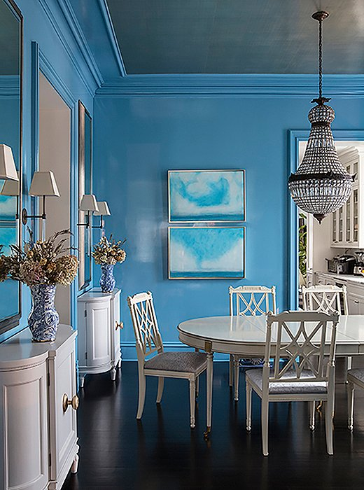 Sky-blue-dining-room-with-all-white-dining-table-chairs-buffets-and-a-crys-wallpaper-wp5809544-1