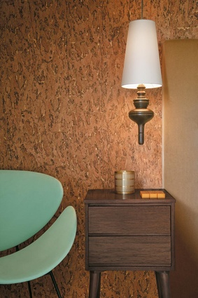 The-bedroom-is-in-retro-luxe-with-Burnished-Cork-by-Ralph-Lauren-and-a-vintage-lip-chair-wallpaper-wp4007887