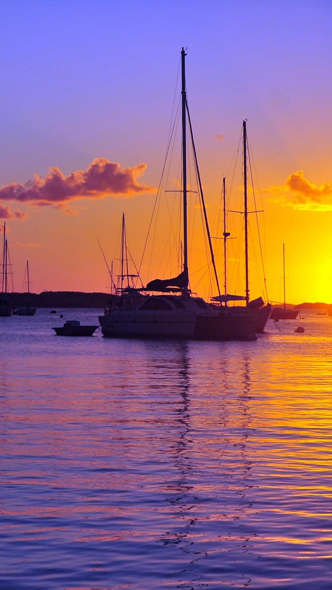 1080x1920-sea-boat-sun-wallpaper-wp360637