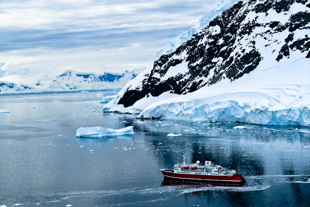 THE-VIEW-UP-ON-THE-MOUNTAIN-AT-NEKO-HARBOUR-ANTARCTICA-IS-AN-INCREDIBLE-ONE-YOU-CAN-SEE-THE-ENTIRE-wallpaper-wpc9009893